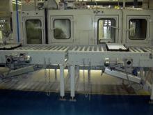 Transportadores de rodillos con transfers de cadenas