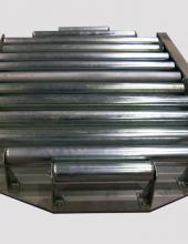 Mesa giratoria Convex para manipulación de palets en líneas de transportadores de rodillos de instalaciones industriales