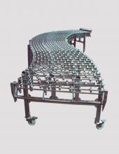 Transportador  extensible de roldanas de doble ballesta serie Convex construido en acero cincado o inoxidable. Longitudes y anchos especiales bajo demanda.