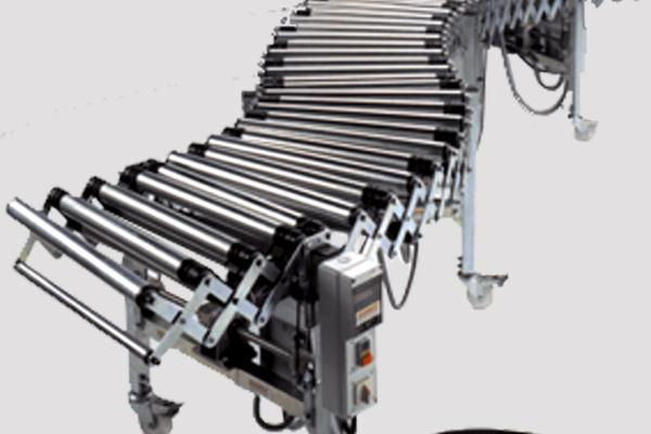 Transportador de rodillos Convex motorizado y extensible para líneas de traslado de cajas en instalaciones industriales