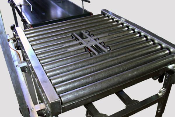 Cruz de giro Convex en transportadores de rodillo para la manipulación de cajas y palets en instalaciones industriales